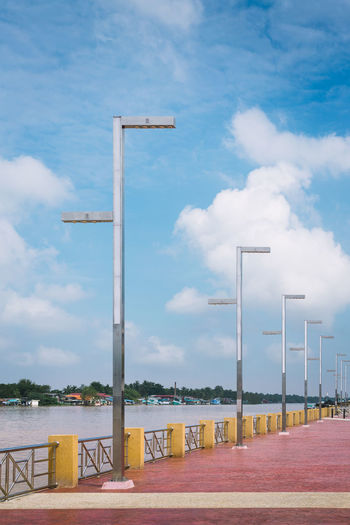 LED street lamps with energy-saving technology, cloud on sky background Air Atmosphere Backdrop Background Blue Bright Electric Electric Lamp Energy Equipment Fixture Guide High Ideas Illuminated Isolated Isolation Lamp Lamppost LED Light Message Monument New Savings Close Up Technology