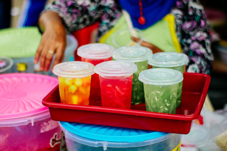 Food And Drink Midsection Food Drink Indoors  Container Refreshment Real People Freshness One Person Focus On Foreground Women Drinking Glass Multi Colored Household Equipment Table Lifestyles Plastic Glass High Angle View Tray