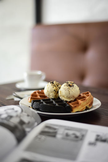Close-Up Of Waffles With Ice Cream On Table