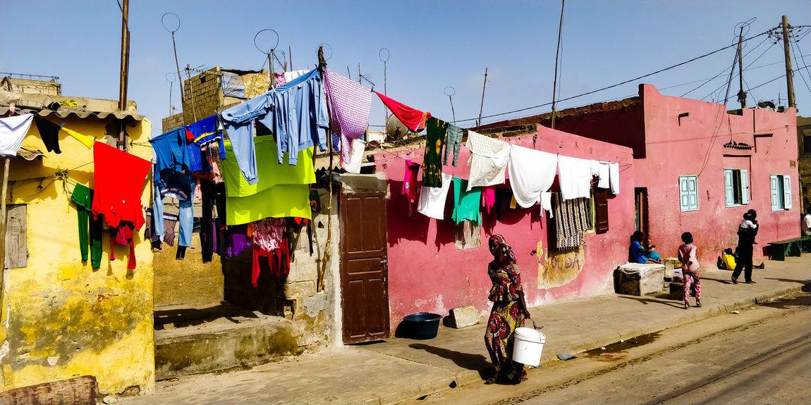 une rue du quartier des pêcheurs. Saint Louis, Sénégal Senegal Saint Louis Afrique Love Africa Africa Multi Colored Laundry Hanging Multi Colored Sunlight Sky Laundry Drying Clothes