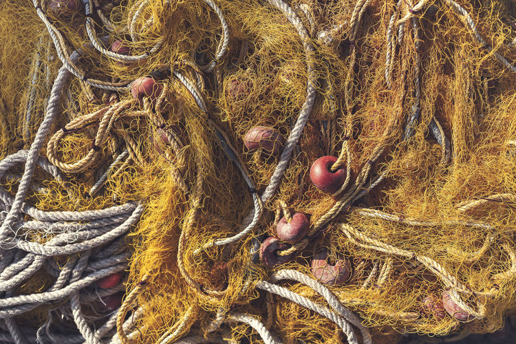 Fishing Net Backgrounds Buoy Close-up Commercial Fishing Net Complexity Day Fishing Fishing Industry Fishing Net Full Frame High Angle View Outdoors Plant Rope Still Life Tangled Water
