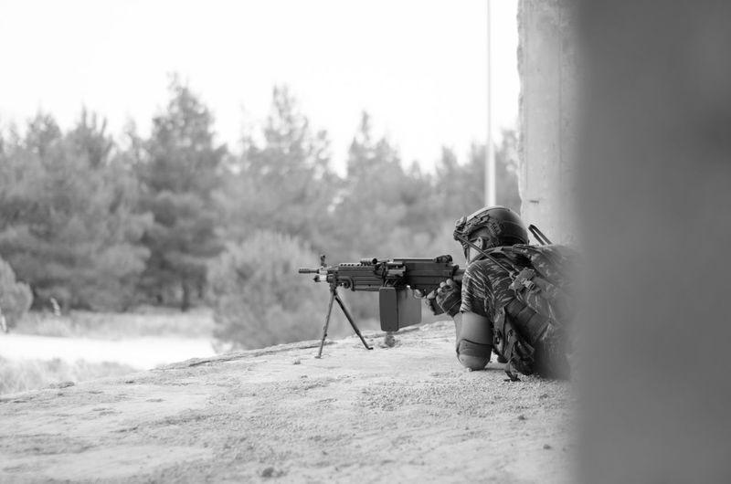 Army solider with machine gun on field