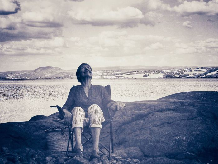 Waiting for the sun to come back Sky Cloud - Sky One Person Land Nature Front View Scenics - Nature Water Sea Sitting Real People Beach Landscape Beauty In Nature Leisure Activity Environment Child Women Outdoors Full Length