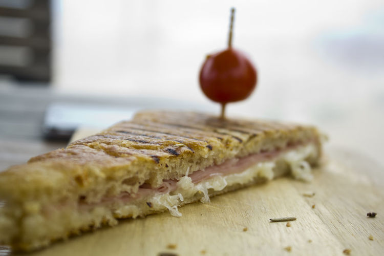 Ham and cheese toast on a wooden board Breakfast Lunch Meal SLICE Sandwich Snack Toast Bread Delicious Food Fresh Freshness Ham And Cheese Indulgence Melted Cheese Ready-to-eat Sandwich Sliced Sliced Bread Tasty Temptation Toasted Bread Tomato Wood - Material Wooden Board