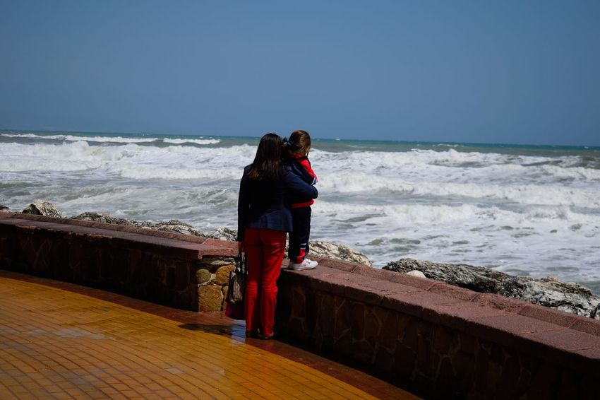 Beach Beauty In Nature Dream Full Length Horizon Over Water Kid Love Mother Nature Outdoors People Power Power In Nature Real People Rear View Scenics Sea Sky Standing Storm Wave Women
