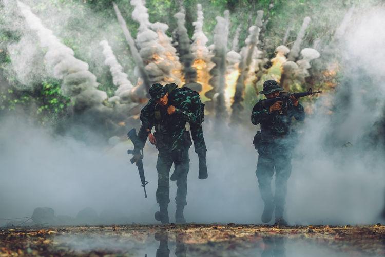 Soldiers fighting in battlefield