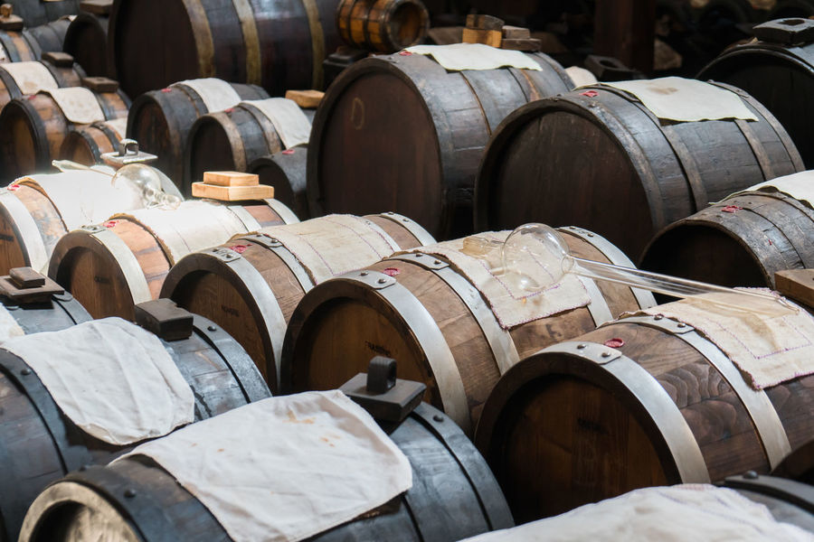 Balsamic vinegar production Bologna Italy Abundance Balsamic Balsamic Vinegar Cask Casks Cellar Fermenting Food Food And Drink In A Row Large Group Of Objects Vinegar Wine Wine Cellar