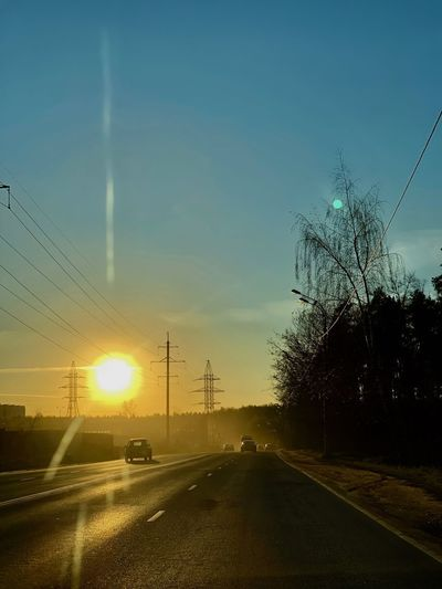 Transportation Road Car Motor Vehicle The Way Forward Direction Sun Mode Of Transportation No People Car Point Of View Power Supply Diminishing Perspective Sunbeam Electricity Pylon Land Vehicle Technology Sunset Sunlight Electricity  Lens Flare Springtime Decadence