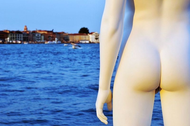 Nude Mannequin Standing Against Calm Blue Sea
