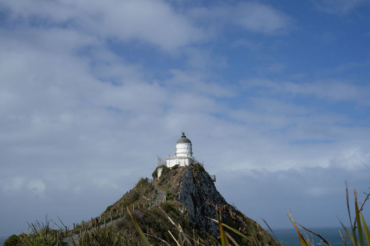 The iconic and historical nugget point light house in new zealand.
