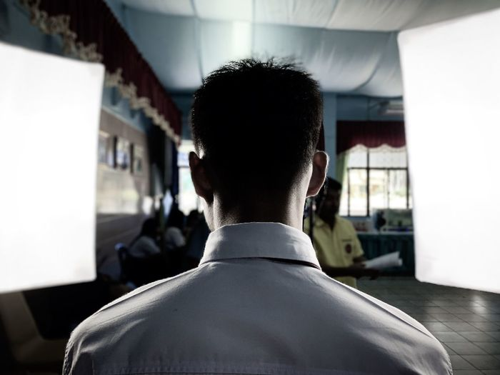 Rear view of man standing in studio