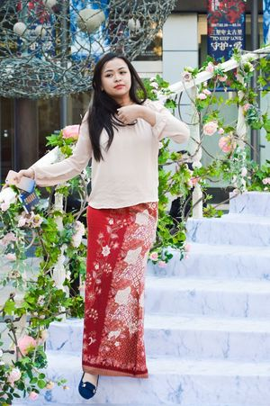 Flower One Person Plant Standing Black Hair Full Length Greenhouse Nature Portrait Beautiful Woman Young Adult People Freshness Botanical Garden Day Smiling Outdoors Adults Only Adult