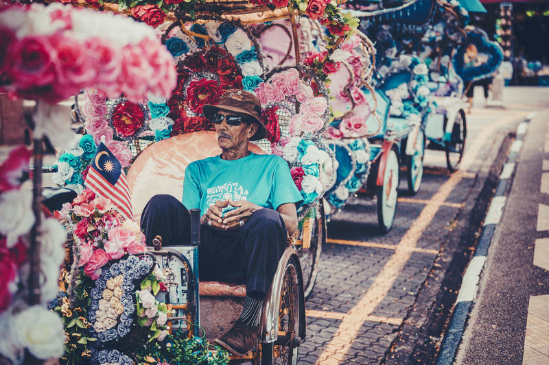 beca, melaka, malaysia ASIA Asian  Melaka, Malaysia. Transportation Working Adult Adults Only Clown Culture Day Flower Full Length Lifestyles Looking At Camera Malacca Men One Person Outdoors People Portrait Real People Sitting Smiling Young Adult