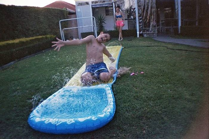 Summer Fun. Photography Photos Photo Photographer VSCO Vscocam Vscocamphotos Vscoaustralia Vscomelbourne Snapseed Justgoshoot Capture Melbourneiloveyou Film Filmphotography 35mm Lomography Lomo DianaMini Lasardinia Summer Fun Sprinkler Water Wet slide heat