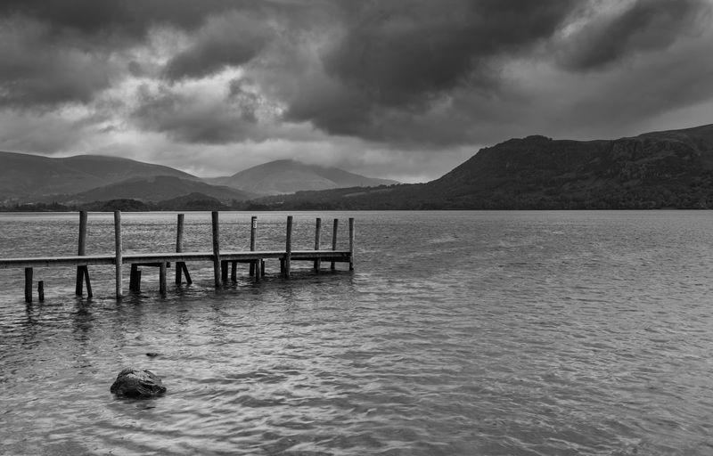 Brandlehow Jetty under a moody sky Autumn Canvas Cloud Cumbria Derwent Water Heavy Rain Lake District Moody Sky Storm Storm Chasing Weather Winter Beauty In Nature Black And White Brandlehow Keswick Landscape Monochrome Mountain No People Pier Season  Sky Tourism Water