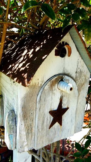 Birdhouse Walking The Streets Street Photography Outdoors Shadow Close-up Decorative House Bird Light And Shadow Multicolored Weathered Copyspace Background Tranquility Rusted Summertime Rust Wood Weathered Wood Home Knob Star Cobweb Sommergefühle