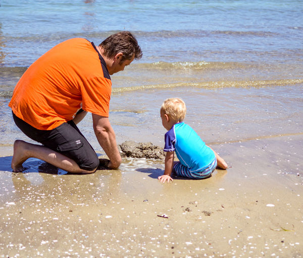 Water Childhood Males  Child Boys Beach Family Sand Togetherness Offspring Sea Father Son Positive Emotion Innocence Leisure Activity Full Length Father And Child Father And Sons Two Parenting Parenthood