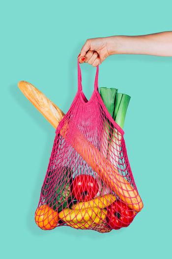 Baguette Eco Fashion Green Mesh Shopping Vegetables & Fruits Vegetarian Colored Background Cotton Ecological Fashionable Human Hand Mesh Bag Meshpics Mint Color Net Bag One Person Reusable Reusable Bag Shopping Bag String Bag Studio Shot Trendy Women