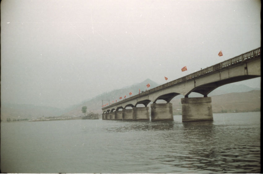Analogue Photography Bad Weather Bombed Bridge Bridge - Man Made Structure Chinese Flags Connection Dark Sky Half Bridge Nature North Korea Outdoors River Sky Water Waterfront