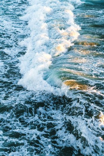 Wave Motion Sea Water Nature No People Beauty In Nature Waterfront Outdoors Power In Nature Day Crash Ocean Surf Blue Golden Hour