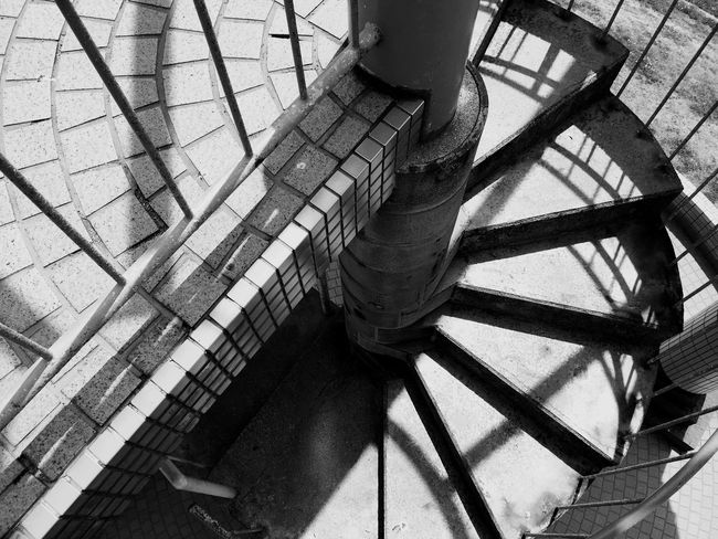 EyeEm Selects Steps And Staircases Staircase Steps Architecture Railing Stairs Built Structure No People Day Low Angle View Spiral Staircase Indoors  Black And White