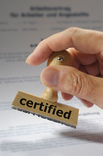 certified printed on rubber stamp in hand Accepted Assent Certified Acceptance Accreditation Agree Agreement Allow Allowance Approval Approved Attested Certificate Certification Close-up Compliance Confirmation Confirmed Consent Document Holding Human Hand Paper Stamp Text
