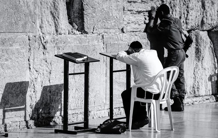 Jerusalem at wailing wall Abandoned Alone B&w Photography B&w Street Photography Broken Chair Day Gun Israel Jerusalem Klagemauer Lifestyles Light And Shadow Maschinengewehr Occupation Prayer Praying Sitting Solda Soldier Streetphoto_bw Togetherness Wailing Wall Wall Wall - Building Feature An Eye For Travel This Is Masculinity