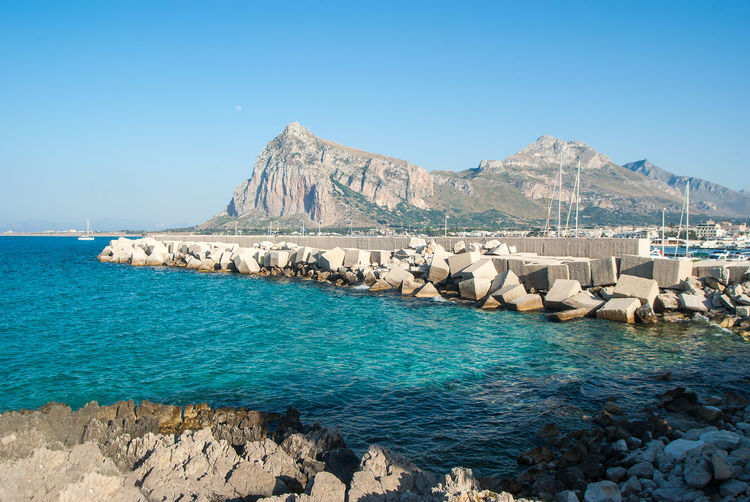 Beautiful View of San Vito Lo Capo town in Sicily San Vito Lo Capo Sicily Beauty In Nature Blue Clear Sky Copy Space Day Idyllic Land Mountain Nature No People Outdoors Rock Rock - Object Scenics - Nature Sea Sky Solid Tranquil Scene Tranquility Turquoise Colored Water