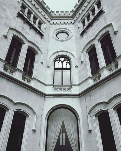 Architecture Arch Built Structure Window History Building Exterior Politics And Government Outdoors Travel Destinations Day Low Angle View No People Sky Glass Reflections Reflection Tranquil Scene City Illuminated Personal Perspective Cityscape Chill Beautiful Miramarecastle Miramare Trieste The Architect - 2017 EyeEm Awards