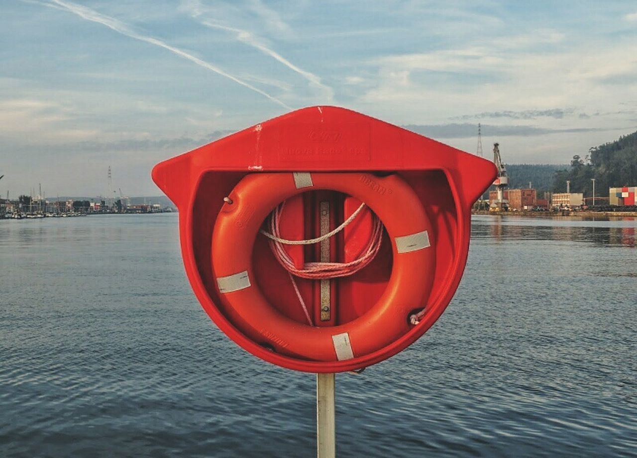 RED UMBRELLA ON SEA AGAINST SKY