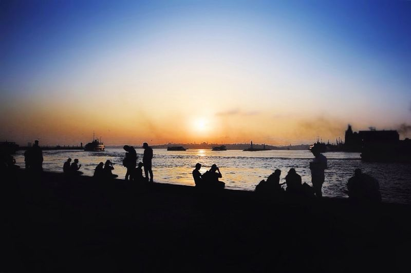Silhouette Sunset Sea Water Beach Nature Sky Scenics Beauty In Nature Outdoors Istanbul Kadikoy Real People Horizon Over Water Men Lifestyles Large Group Of People Clear Sky Day People