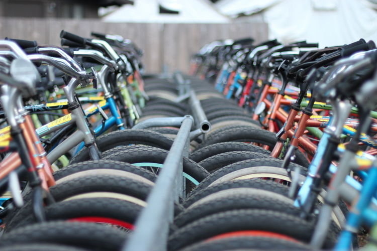 Abundance Bicycle Rack Close-up Coathanger Day Hanging In A Row Large Group Of Objects Multi Colored No People Outdoors Selective Focus Variation