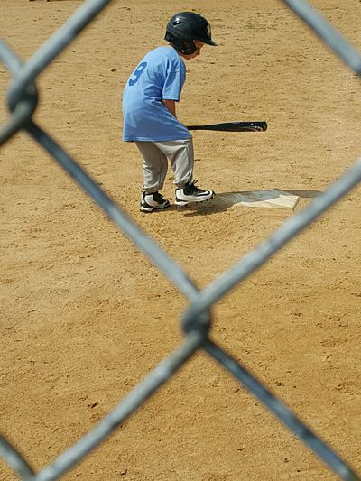 Taking Photos Check This Out EyeEm Gallery Baseball Little Boy Little Boy Blue Ballgame Baseball Game Little Boy Playing Baseball Summer Fun Showcase June Little Boy Playing Anticipation Getting Ready For The Game! Gametime Ball Tball Perspective Thru The Fence