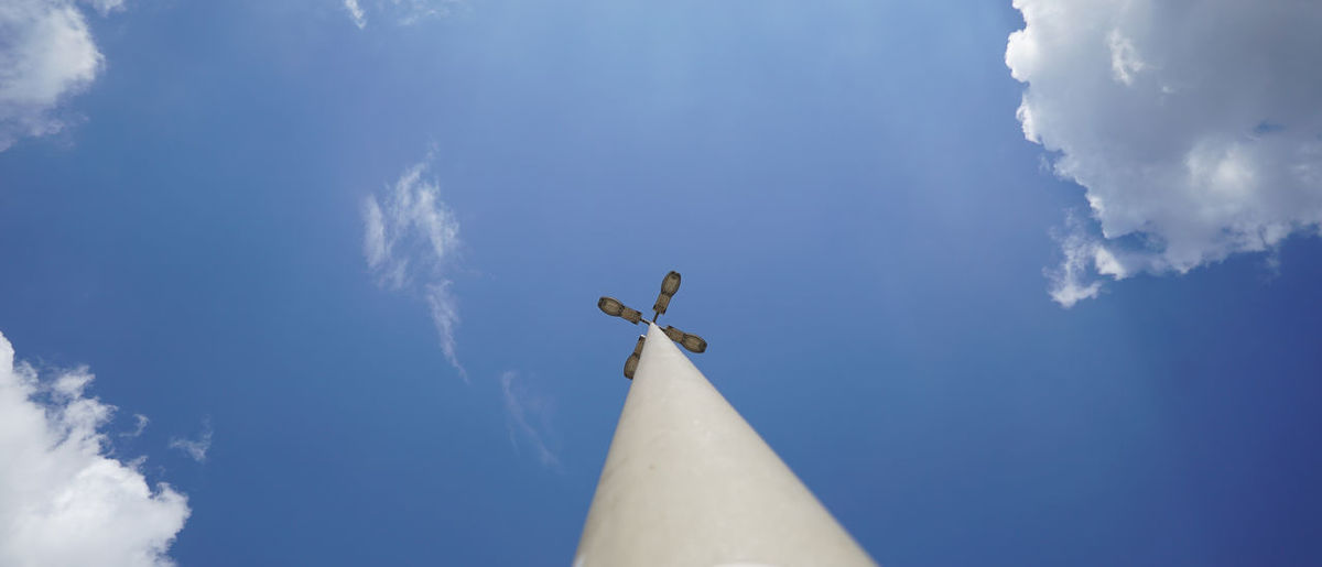 Low angle view of a sculpture against blue sky