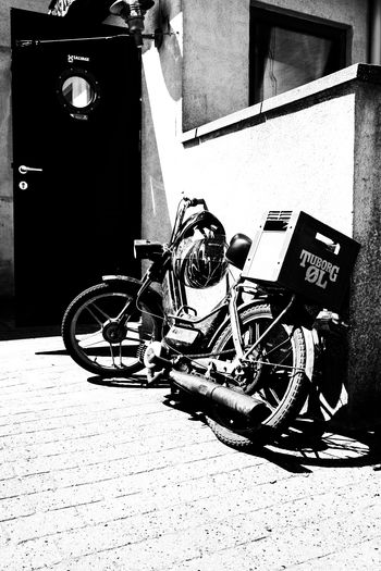 In front of a danish pub. Absence Architecture Building Building Exterior Built Structure City Day Footpath Garage Land Vehicle Mode Of Transportation Motorcycle No People Outdoors Scooter Stationary Street Sunlight Transportation Wall Wall - Building Feature