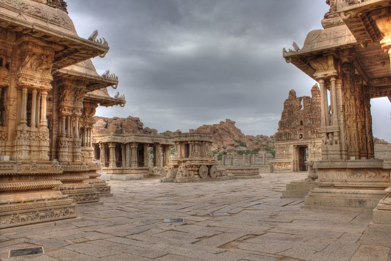 Historic temples against cloudy sky