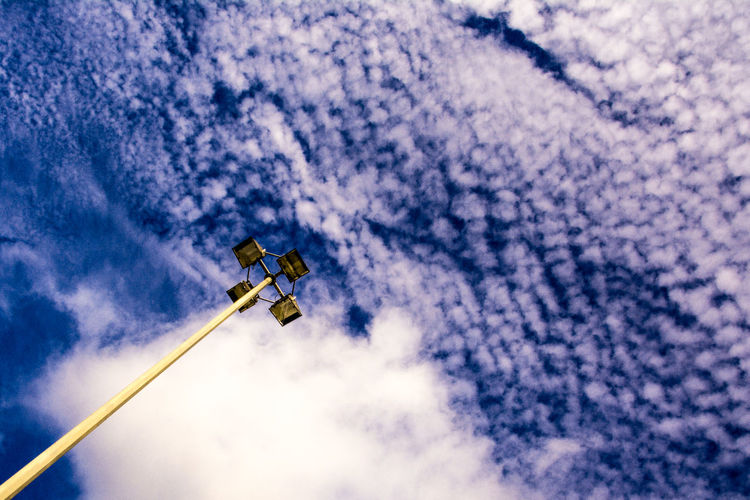 Low angle view of vapor trail against sky