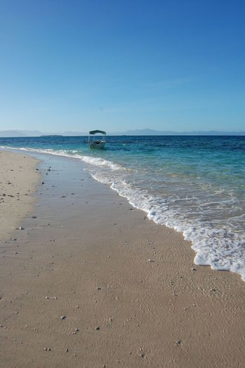 Beachcomber Island. Fiji Sea Water Beach Land Horizon Over Water Sky Horizon Sand Scenics - Nature Beauty In Nature Clear Sky Motion Nature Day No People Tranquility Tranquil Scene Blue Mode Of Transportation Outdoors Turquoise Colored Waves Fiji Fiji Islands Tropical Beachcomber Island
