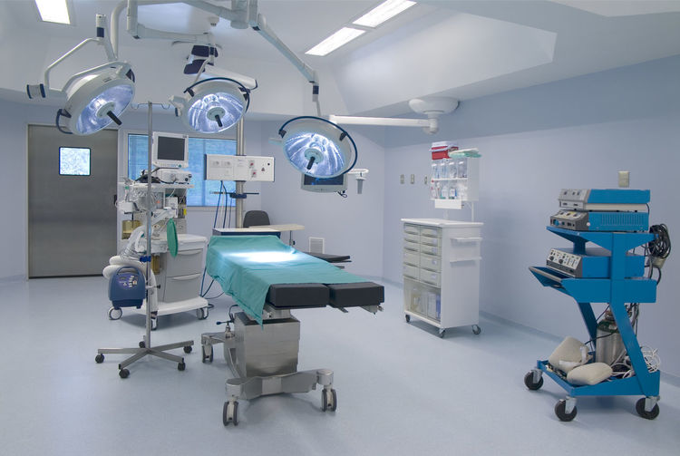 Interior of illuminated modern operating room at hospital