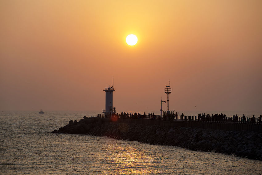 sunset at Gyeokpo Port in Byeonsan, Buan, Jeonbuk, South Korea Beauty In Nature Building Exterior Built Structure Day Drilling Rig Horizon Over Water Lighthouse Nature Nautical Vessel No People Orange Color Outdoors Scenics Sea Sky Sun Sunset Water Waterfront