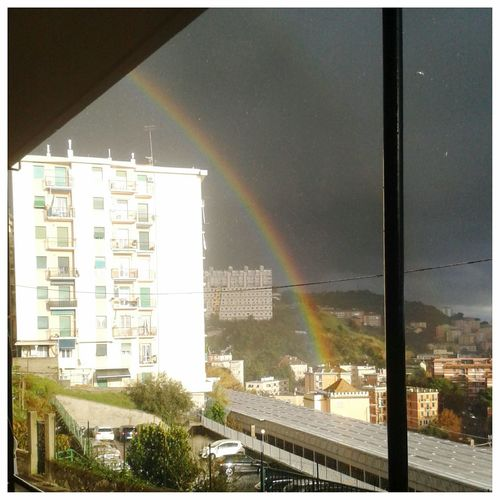 The closest rainbow that I have ever seen. Atmospheric Physics Arcobaleno  Rainy Days Banda Alessandrina Rifrazione Smartphone Photography Mobilephotography S3 Mini City Cityscape Urban Skyline Rainbow Sky Architecture Building Exterior Built Structure Refraction Physics Double Rainbow Spectrum