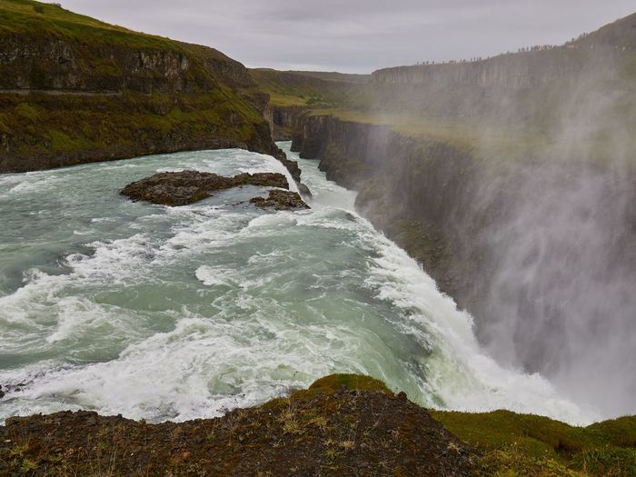 Scenic view of waterfall in sea