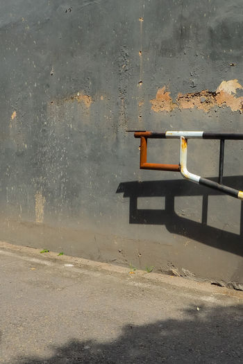 Empty chair against wall in old building