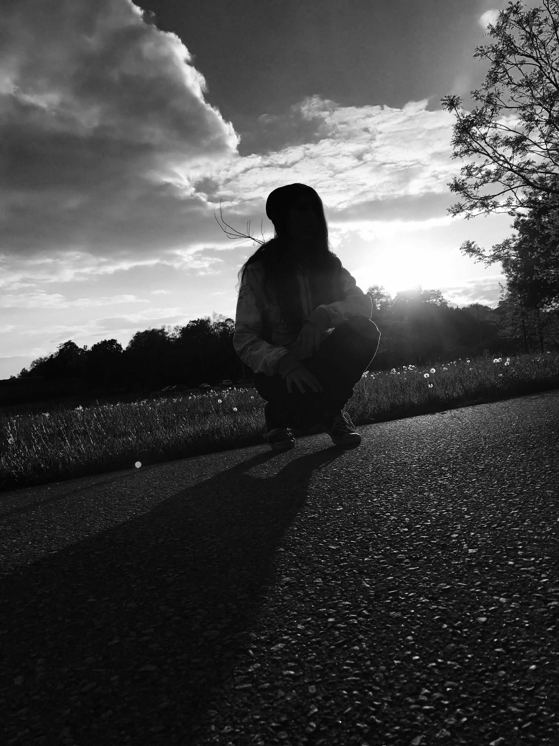 one person, full length, real people, leisure activity, sunlight, lifestyles, sky, outdoors, silhouette, women, road, shadow, nature, day, people