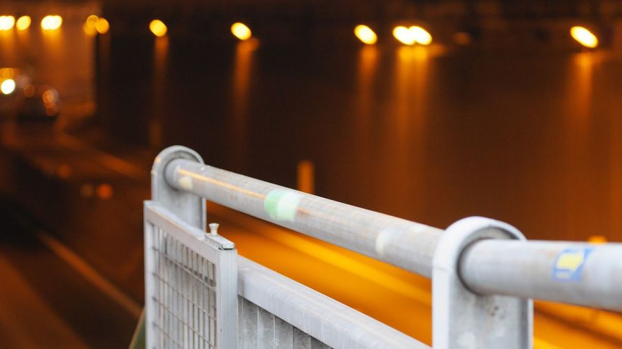 Underpass EyeEm Selects Metal No People Close-up Focus On Foreground Illuminated Railing Orange Color Lighting Equipment Yellow Selective Focus