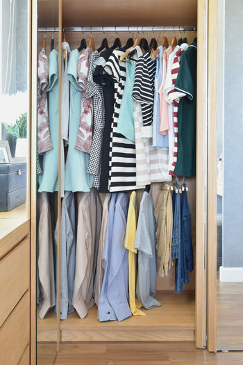 Colorful clothes hanging in wardrobe Choice Closet Clothes Rack Clothing Coathanger Collection Consumerism Day Fashion Garment Hanging In A Row Indoors  Jeans Large Group Of Objects No People Rack Retail  Retail Display Sale Shopping Store Textile Variation Wood