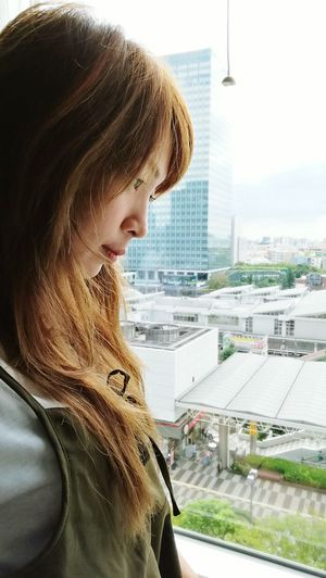 Looking Through Window Window Contemplation City Side View Cityscape Headshot One Person Journey Day Dreaming Outdoors Day Portrait People Only Women Business Finance And Industry One Woman Only Urban Skyline Adults Only Building Outside New Life Japan EyeEmNewHere The City Light Long Goodbye