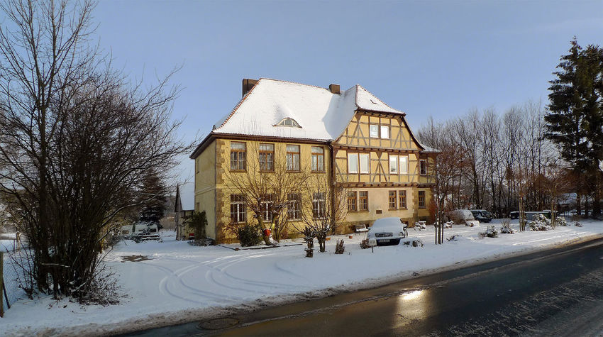 Architecture Bare Tree Building Exterior Built Structure Calden Meimbressen City Clear Sky Cold Temperature Day House Nature No People Outdoors Road Schule Sky Snow Tree Winter