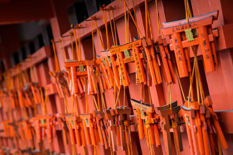 Close-Up Of Torii Gates Hanging At Market Stall