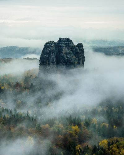 Rock formation in a sea of fog